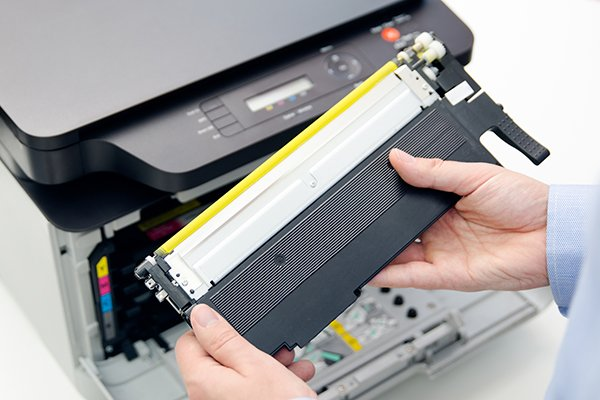 Man replacing printer toner